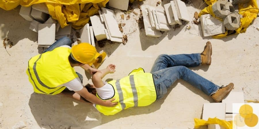 Workers' compensation worklace injury scene of employee helping injured colleague
